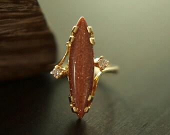 Vintage 14K gold large goldstone marquis ring