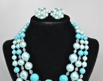 Vintage Signed JAPAN Powder Blue Triple Strand Necklace with Matching Cluster Earrings