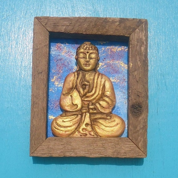 The golden buddha relief carving in rustic wood by susanacaban