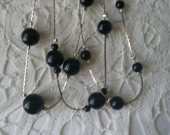 Vintage Multi Sized Black Beads on a Three Strand Silver Necklace