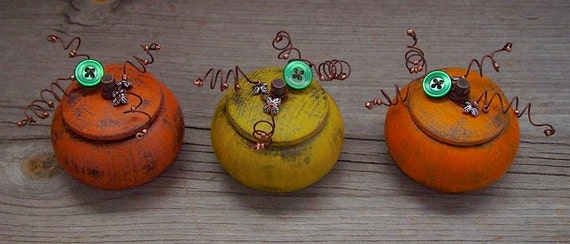 3 Little Rustic Country Farmhouse Pumpkins designed in fall colors with rusty curled wire and vintage green buttons