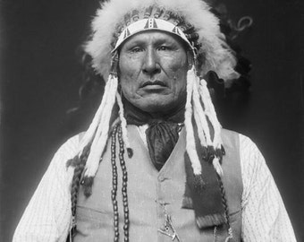 Vintage image of Wooden Leg Indian Chief,  suitable for framing.