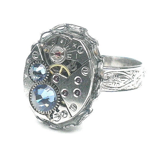 152c65f9d This beautiful ring was made with a Vintage, 17 Ruby Jeweled, Watch Movement,  bejeweled with two Tanzanite blue Swarovski Crystals.