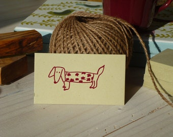Charity Sausage Dog in Coat Olive Wood Stamp