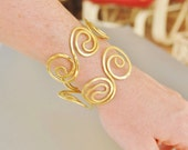Chunky brass spiral bracelet yellow gold color