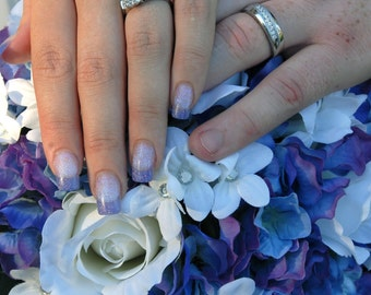 Blue purple hydrangea, white rose and jeweled stephanotis bridal bouquet