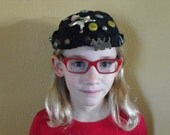 Vintage black felt beanie with attached charms, pins, charms and other oddities