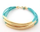 Faux Wrap Turquoise Bracelet | gold tubes and turquoise cord bracelet