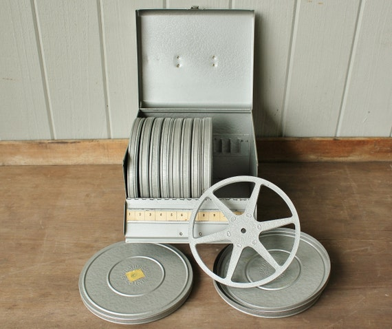 old movie reel case with 3 reels 1 line