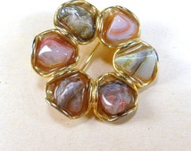 Vintage gold toned metal polished quartz brooch pin
