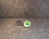A miniature plate with cupcakes and frog