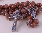 handmade Catholic rosary in silver with mottled mauve glass beads