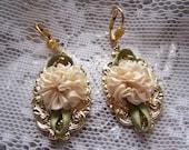 Creamy rosettes on gold filigree earrings