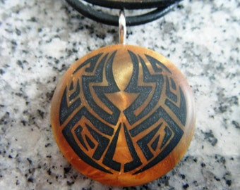 Ancient Mayan Maze hand carved on a polymer clay Antique gold/Gold color background. Pendant comes with a 3mm necklace