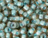 Seed Beads-8/0 Round-952 Inside Color Rainbow Lt Topaz Sea Foam Lined-Toho-16 Grams