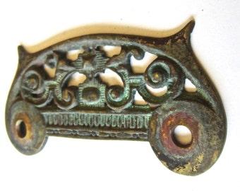 Ornate brass pull plate