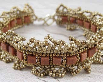 gold brown bracelet - beadwoven goldstone with ruffle