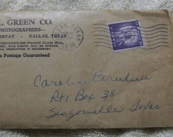 1958 Vintage photographs from H.L. Green Co plus shipping envelope