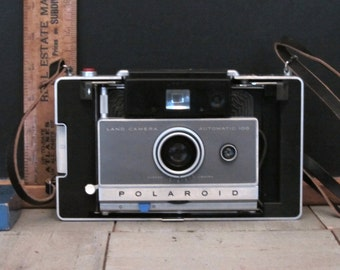 Vintage Polaroid Camera 100 Land Series with accessories