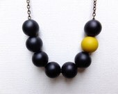 Black Beaded Asymmetrical Necklace with Single Mustard Yellow Bead Feature, Handmade, Abacus Chain