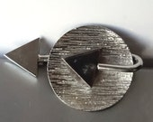 Atomic age silver plated brooch
