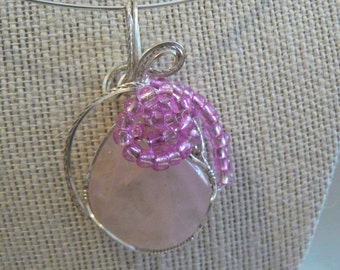 Rose Quartz tear drop wrapped in sterling silver with pink beads