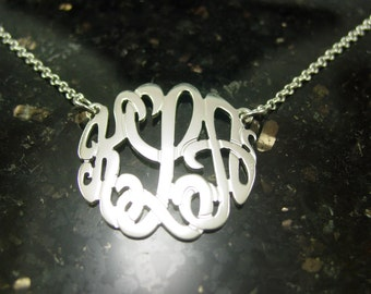 "sterling silver monogram necklace .1.""size. with a  silver chain."