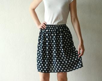 Dark blue, navy polka dot knee high mini skirt