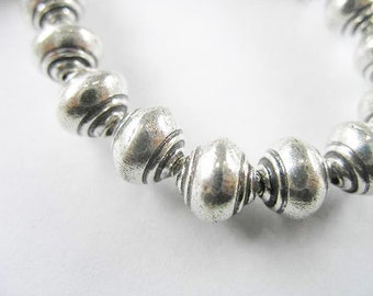 4 of Karen Hill Tribe Silver Shell Beads 8 x 9 mm. :ka3333