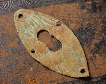 Vintage brass key hole escutcheon. Original dark patina.