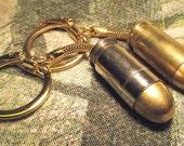 45 ACP handgun bullet key chain fob ring. Brass or Nickel cased.