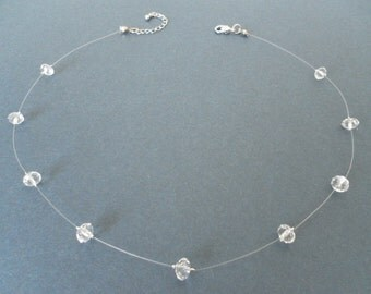 White crystal-like translucent floating illusion necklace, invisible durable line, glow