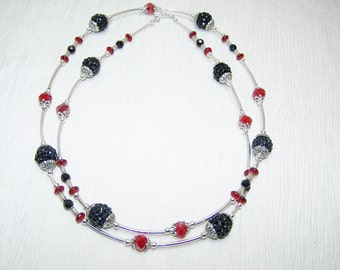 Black and red glass macaroni noodle necklace