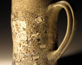 tall textured Beer Stein or  tall coffee cup