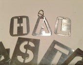 Stamped Alphabet Letter made into charm. Spell or write name or initial. Typewriter type
