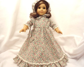 Pink and turquoise floral print on beige, long dress for 18 inch dolls, with beige lace trim.