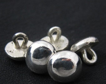 Silver medieval buttons