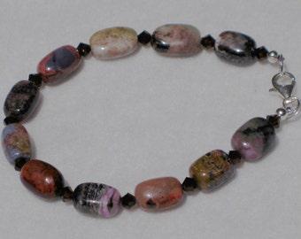 Colorful sugilite and Swarovski crystal bracelet: charity donation