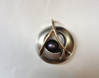 Hand Forged Hunter's Moon Pendant with black pearl, sterling silver, and 14k gold