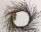 Twig Wreath with Red Berries and Rusty Birdhouse