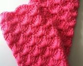 Bright pink fingerless gloves