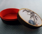 Vintage Oval Paper, Cloth and Porcelain Painted Top Japanese Trinket Box. Bamboo Stick Scenery.