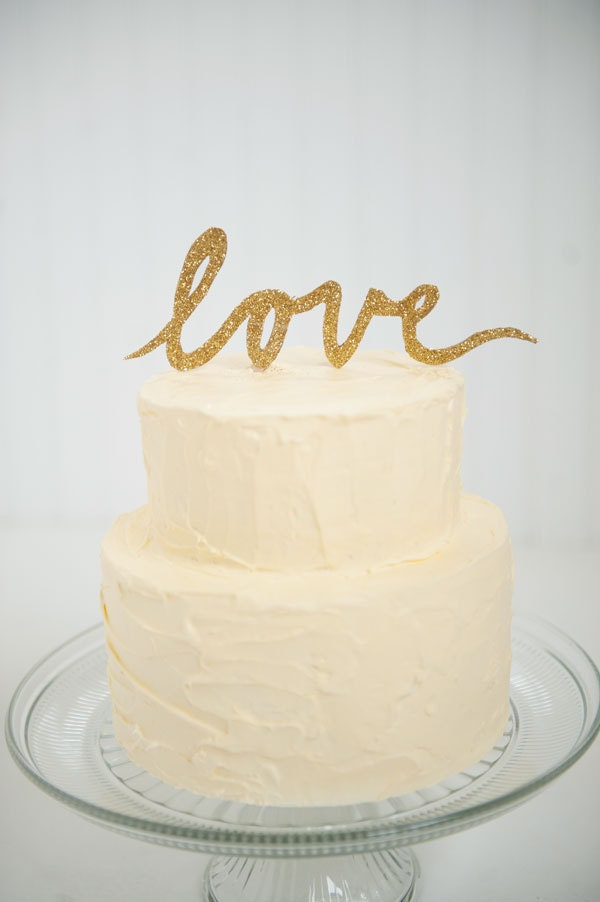 Gold glitter LOVE script wedding cake topper