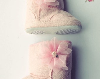 Pink  baby  fuggs crib boots . Baby Girl soft sole booties,Girl boots with black  feathers.