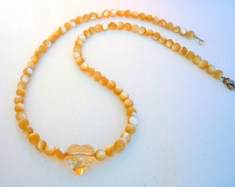 Mother of Pearl necklace with Swarovski Crystal heart.