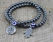 Yoga Hematite Bracelet with Om Charm, Hamsa Charm, Evil Eye Bead