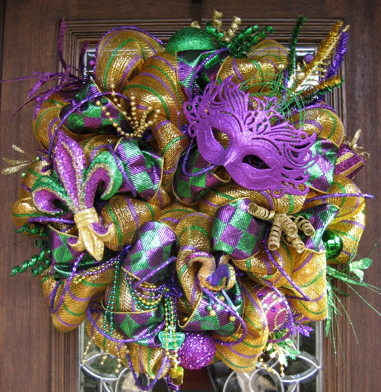 Deluxe deco mesh mardi gras wreath with purple mask by