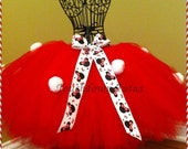 Minnie Mouse tutu with pom pom's. Pictured in red or pink