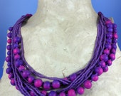 Bahadur Mala-a necklace of Courage in violet/ magenta tones (photo shows two necklaces worn at once)