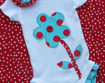 Ruffled onesie with matching hair clip flower